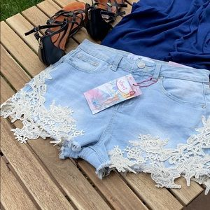 Almost Famous high rise lace trimmed jean shorts